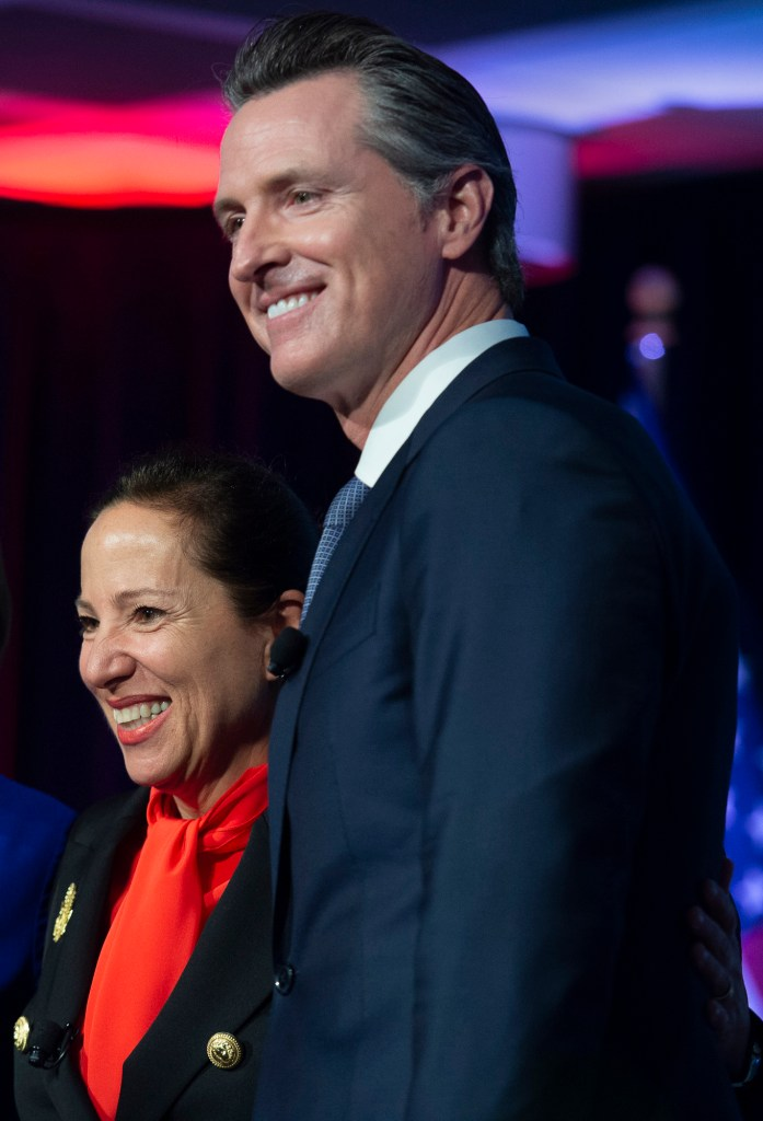 Lt. Governor Eleni Kounalakis and Governor Gavin Newsom stand together on stage at the Tsakopoulos Library Galleria on January 7, 2019 in Sacramento. Photo by Randy Pench for CalMatters