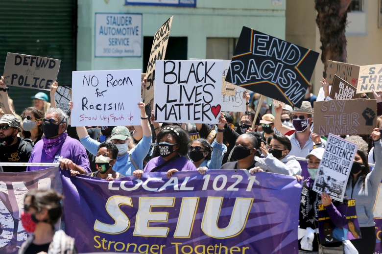 Protesters march down College Avenue to UC Berkeley during a protest against police violence and systemic racism organized by the SEIU Local 1021 in Oakland on June 1, 2020. Photo by Ray Chavez, Bay Area News Group