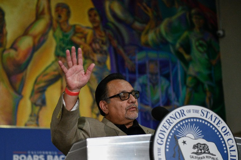 Ron Herrera, executive director of the Hispanic Caucus, delivers a speech during a rally for Gov. Gavin Newsom in El Sereno, on July 13, 2021. Photo by Pablo Unzueta for CalMatters