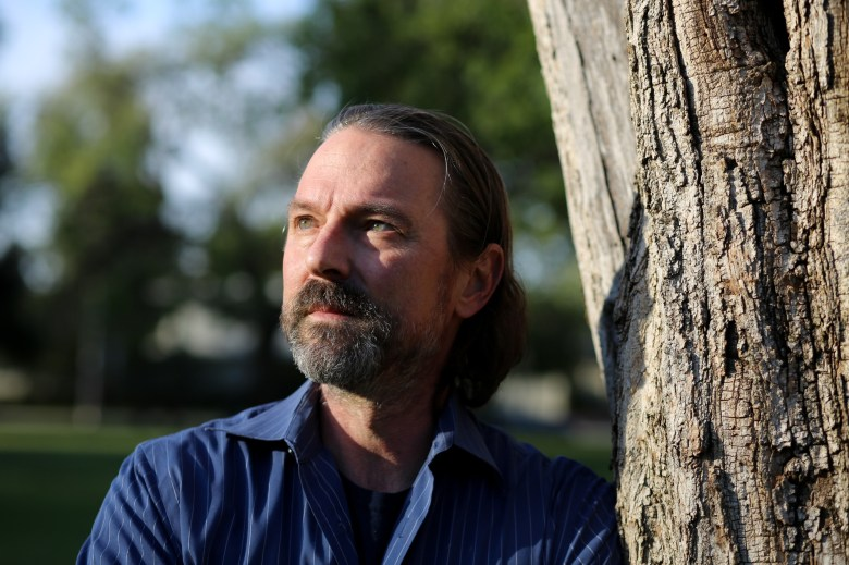 David Walters stands for a portrait at Encino Park in Encino on March 23, 2021. David is an adjunct professor at UC Berkeley lecturing on humanities and creative writing. Photo by Shae Hammond for CalMatters